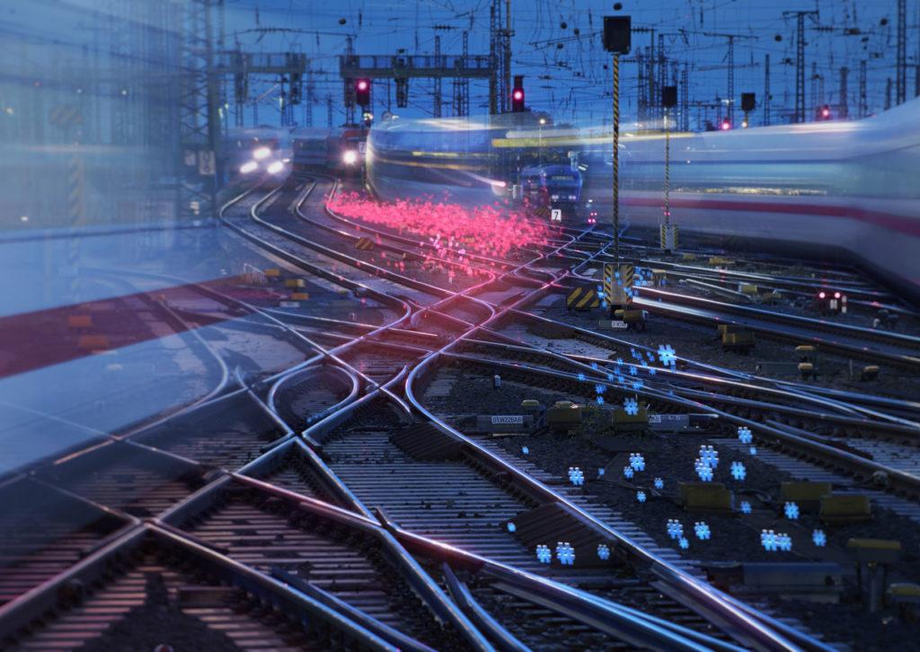 Gleisanlagen und Zugverkehr bei Nacht