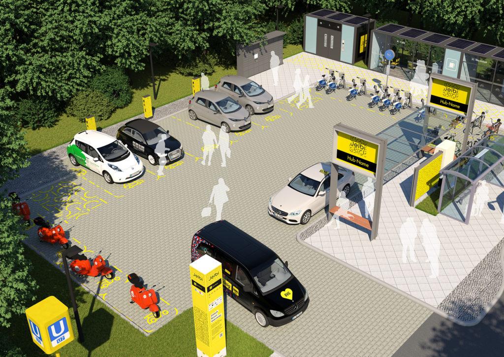 E-Autos, E-Bikes und Bushaltestelle auf einem Areal