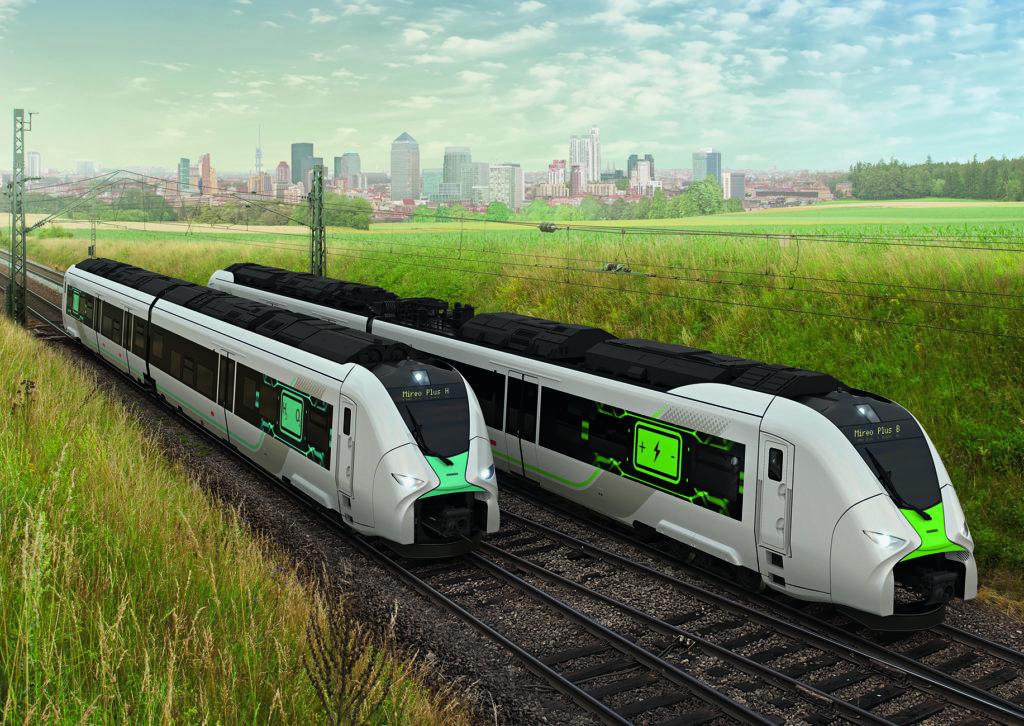 Simulation 2 Züge auf der grünen Wiese, im Hintergrund Hochhäuser einer Stadt