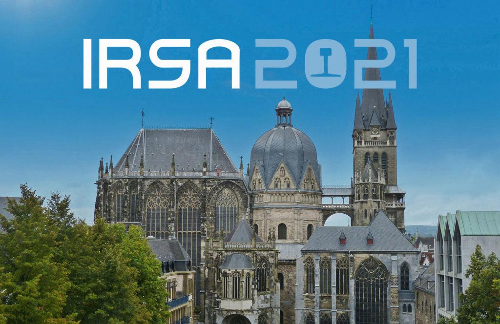 IRSA Logo vor dem Hintergrund des Aachener Doms